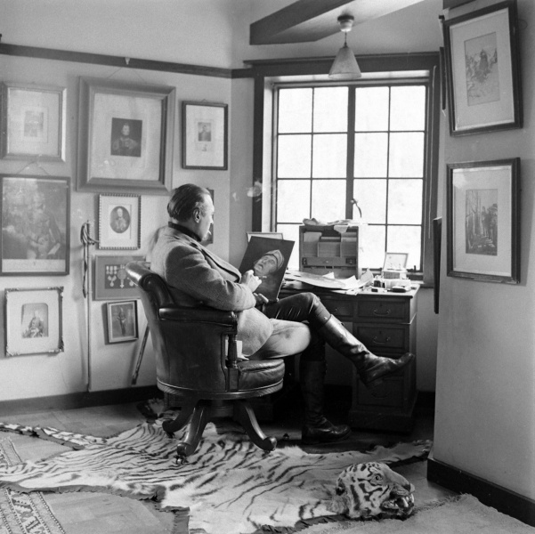 File:1948-03-adrian-conan-doyle-painting-at-his-desk.jpg