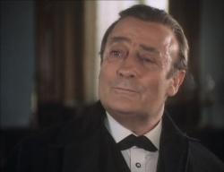 Edward Woodward as Sherlock Holmes in Hands of a Murderer (1990) - 250px-1990-hands-murderer-sherlock-holmes