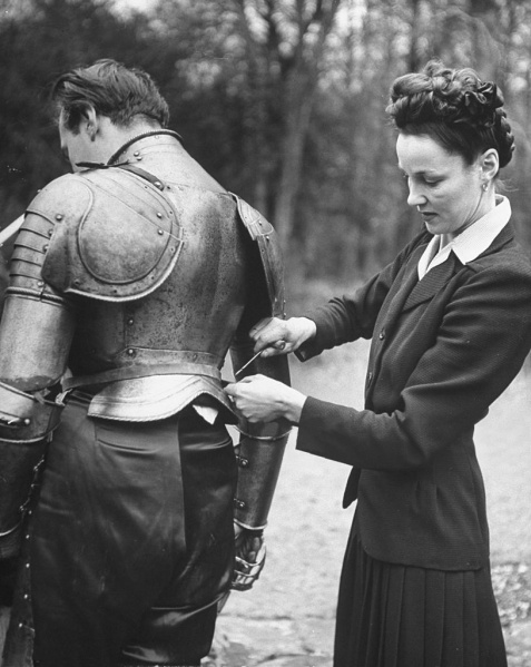 File:1948-03-adrian-conan-doyle-with-his-wife-anna-andersen-repairing-armor.jpg