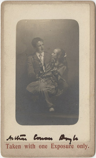 File:Dedicace-undated-photo-card-young-man-with-spirit-girl-on-knees.jpg